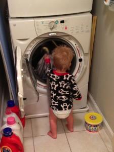 Toddler helping mom